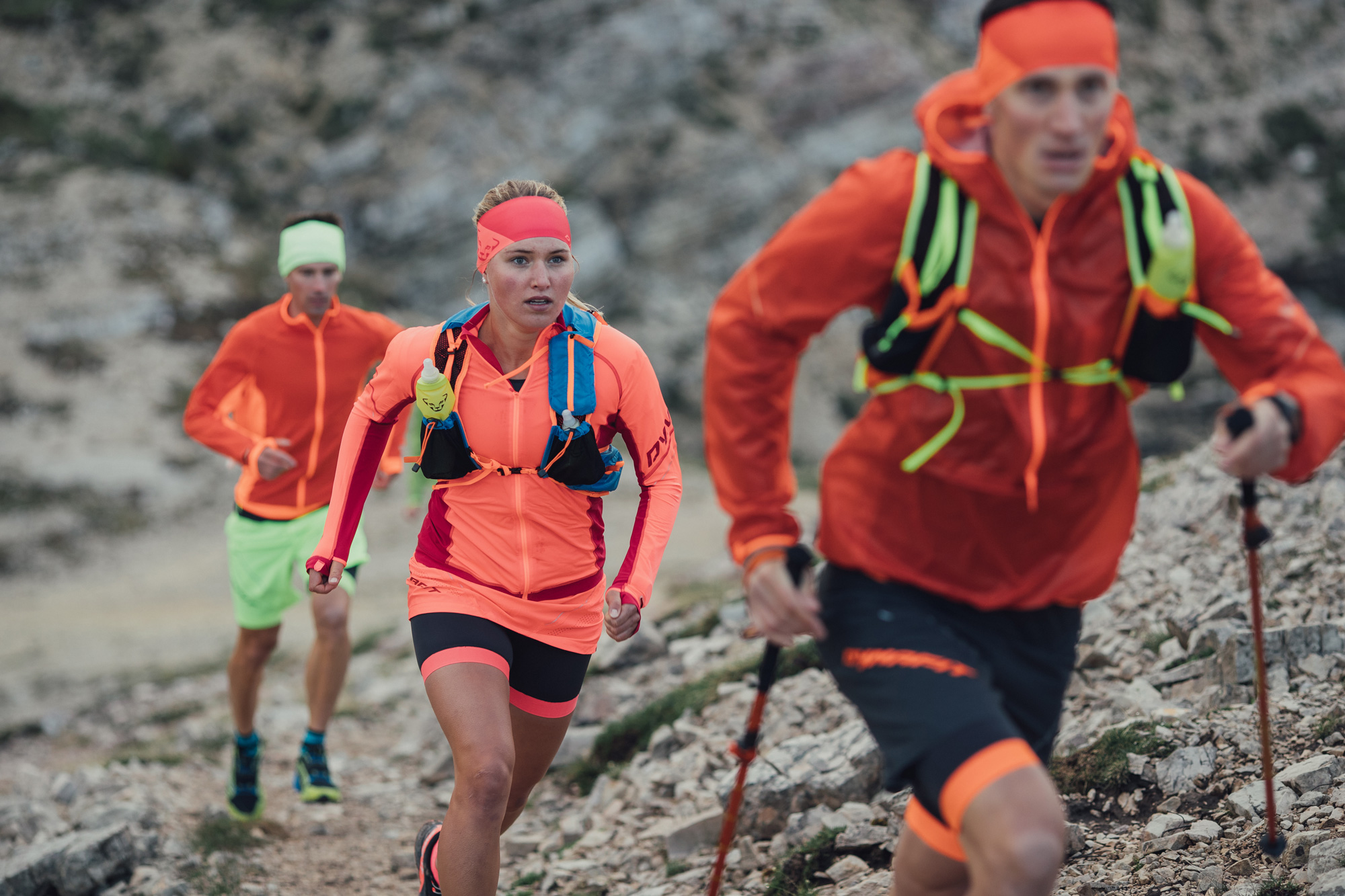 Trail running group with a running backpack